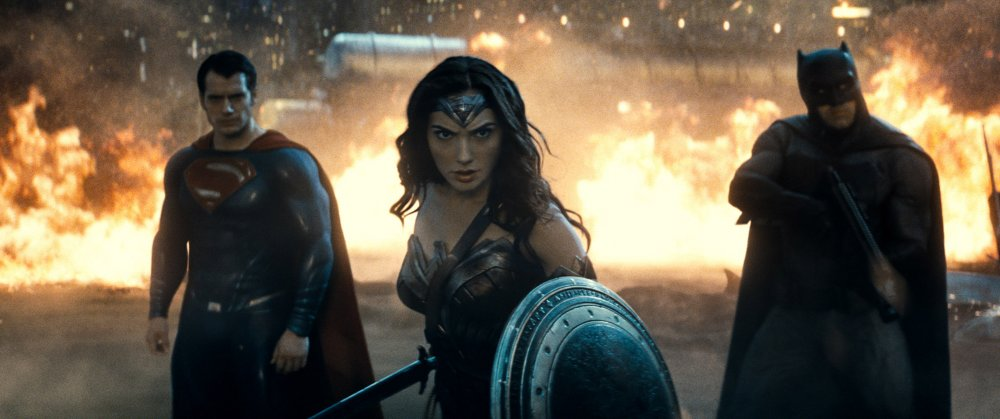 batman-v-superman-dawn-of-justice-2016-002-duo-either-side-of-wonder-woman-against-flames.jpg